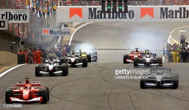 German Formula One driver and current world champion Michael Schumacher powers his Ferrari followed by Colombian Juan Pablo Montoya of BMW/Williams...