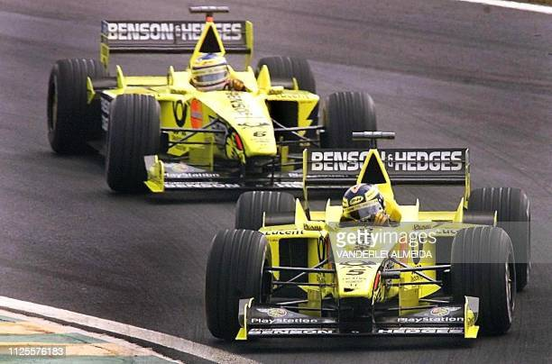German Formula One driver HeinzHarald Frentzen powers his team Jordan car followed by his teammate Italian Jarno Trulli during the Brazil Formula One...