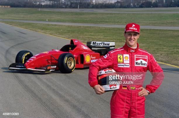 German Formula One driver Michael Schumacher presents the new Ferrari F310 on the Ferrari race tracks on February 4 in Maranello before the 96...