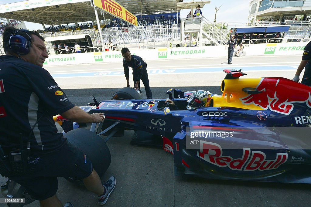 German Formula One driver Sebastian Vettel checks his redBull in the pits during the free practices for the Brazilian GP on Sunday at the Interlagos racetrack on November 22, 2012 in Sao Paulo, Brazil. AFP PHOTO