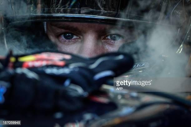 German Formula One driver Sebastian Vettel is pictured before the start of the F1 World Championship seasonending Brazilian Grand Prix at the...