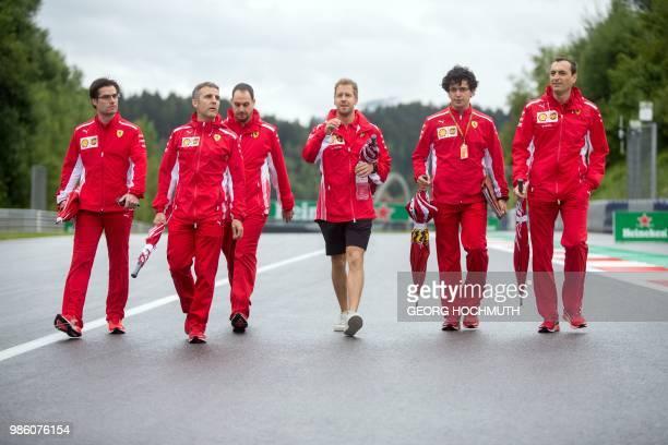 German Formula One Ferrari driver Sebastian Vettel inspects the racetrack ahead of the Austrian Formula One Grand Prix at the Red Bull Ring in...