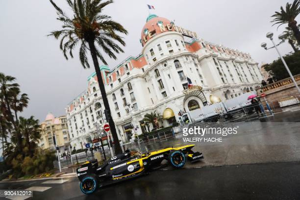 German Formula One pilot Nico Hulkenberg steers a Lotus Renault E20 Formula One racing car during a road street exhibition on the Promenade des...