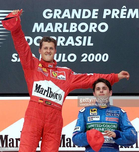 German Formula One world champion Michael Schumacher of team Ferrari with Italian Giancarlo Fisichella of team Benetton during the podium ceremony of...