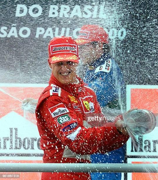 German Formula One world champion Michael Schumacher of team Ferrari celebrates his victory at the podium of the Brazil Formula One Grand Prix 26...