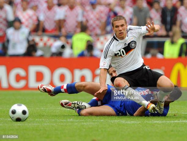 German forward Lukas Podolski is tackled by unidentified Croatian players during their Euro 2008 Championships Group B football match on June 12 2008...