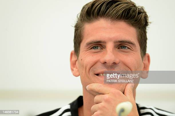 German forward Mario Gomez speaks during a press conference at media center near the Dwor Oliwski hotel in Gdansk on June 15 during the Euro 2012...