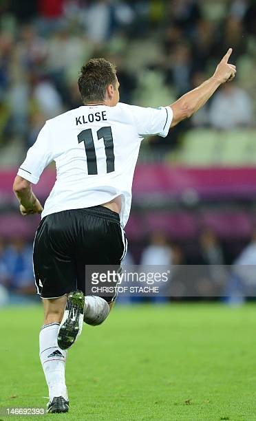 German forward Miroslav Klose celebrates after scoring during the Euro 2012 football championships quarterfinal match Germany vs Greece on June 22...