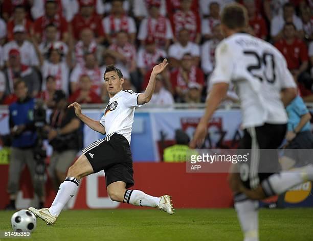 German forward Miroslav Klose , flanked by German forward Lukas Podolski , runs after the ball during their Euro 2008 Championships Group B football...