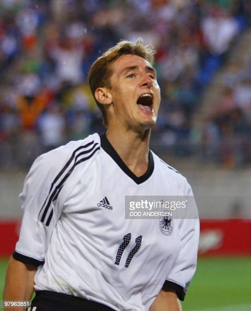 German forward Miroslav Klose reacts after he scored a goal during the Group E first round match Germany/Ireland of the 2002 FIFA World Cup in Korea...