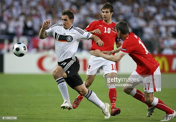 German forward Miroslav Klose vies with Austrian midfielder Andreas Ivanschitz and Austrian defender Martin Hiden during the Euro 2008 Championships...