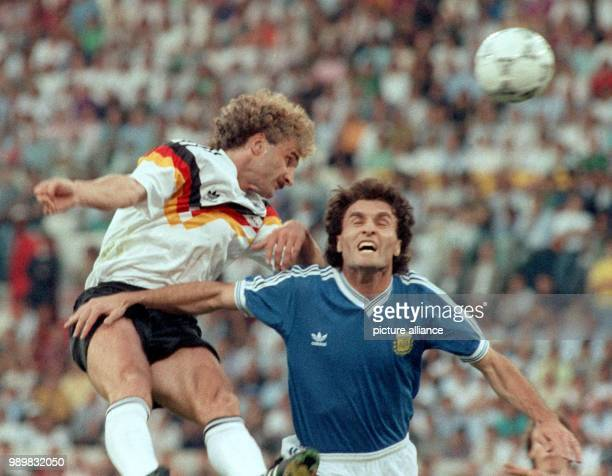 German forward Rudi Voeller and his Argentinean opponent Oscar Ruggeri are fighting for the ball The German national team wins the World Cup final...