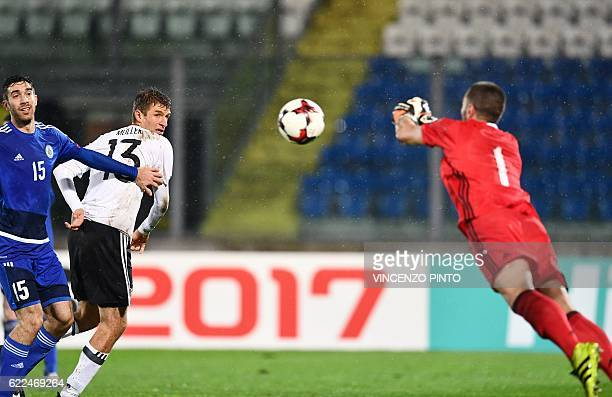 German forward Thomas Mueller heads the ball during the World Cup 2018 qualifying soccer match San Marino vs Germany at the San Marino stadium in...