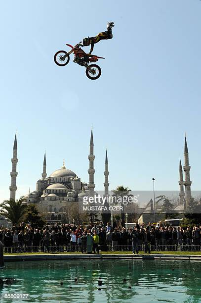 German free style motocross champion Tom Ferber performs in front of Blue Mosque in Istanbul on April 05 2008 AFP PHOTO / MUSTAFA OZER