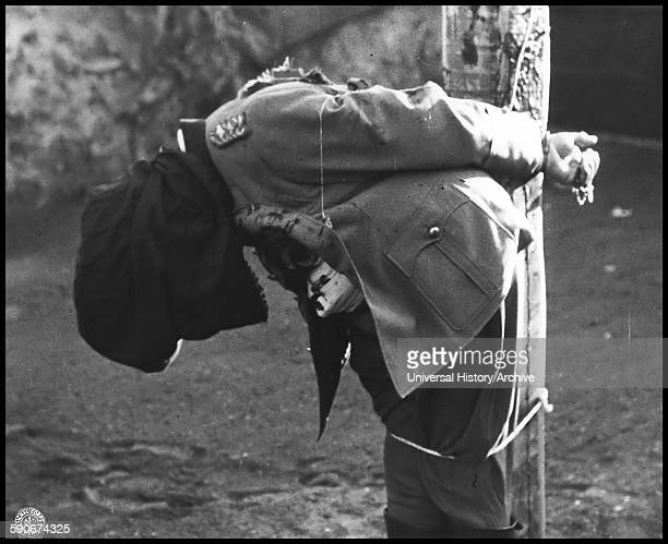 German General Anton Dostler tied to a stake during his execution by a firing squad Italy 1945