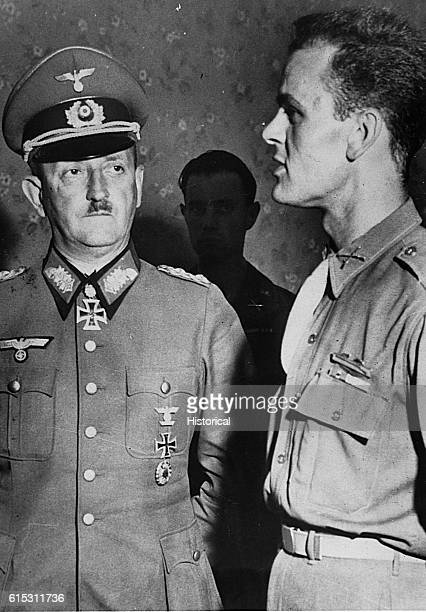 German General Heinrich von VietinghoffSchiel is questioned by US Captain Ralph C Opperman interpreter for Lt General Truscott | Location indoors