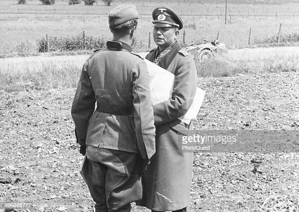 German General Heinz Guderian conferring with staff on the road Le Quitteur France June 16 1940