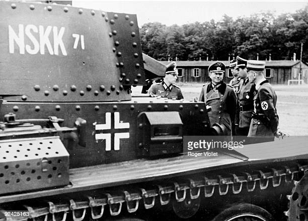 German General Heinz Guderian inspector of the German motorized army on a training ground of Panzer unities accompanied with Major Kraus June 1943