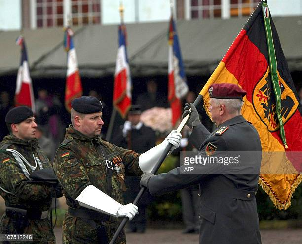 German General Werner Freers is offered the flag of the squadron during a ceremony in the eastern French city of Strasbourg on December 10 to mark...