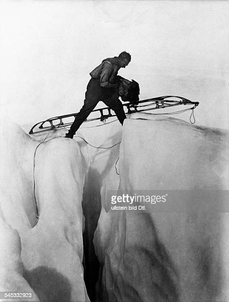 ALFRED LOTHAR WEGENER German geophysicist and meteorologist Photographed crossing a glacier during his final expedition to Greenland November 1930