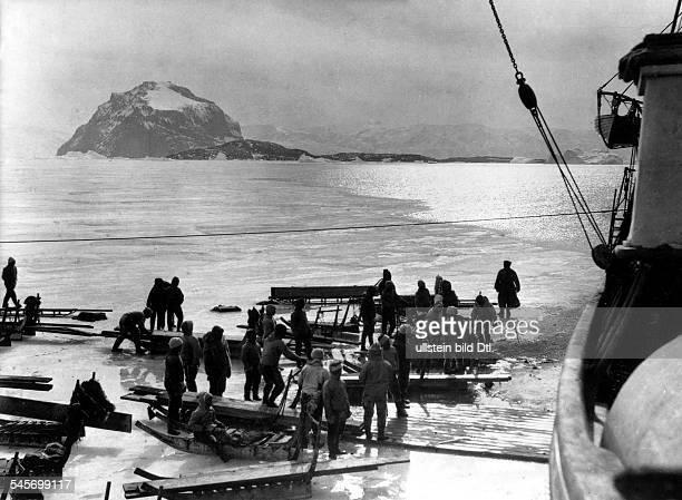ALFRED LOTHAR WEGENER German geophysicist and meteorologist Wegener's team during their expedition to Greenland Photograph November 1930