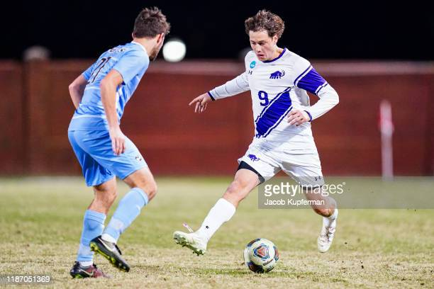 German Giammattei of Amherst Mammoths with the ball during the Division III Men's Soccer Championship held at UNCG Soccer Stadium on December 7 2019...
