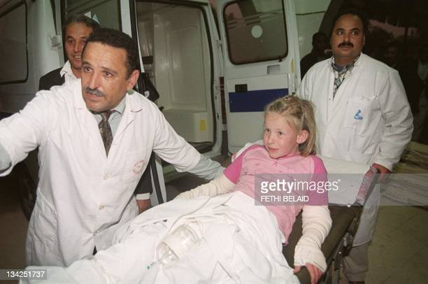 German girl Allissa Telschmer is wheeled into the Tunis hospital 12 April 2002 after she suffered burns as a result of the blast at the Djerba...