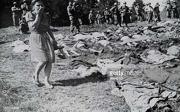 German girl expresses horror at the sight of the decomposing bodies of the slain victims, German civilians of Namering were ordered by Military...