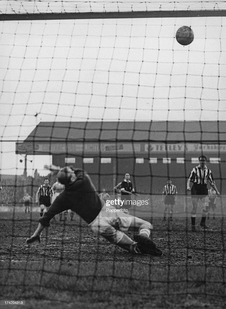 German goalkeeper Bert Trautmann (1923 - 2013), of Manchester City FC, fails to stop Newcastle United's second goal during an FA Cup Third Round Replay at Maine Road, Manchester, 9th January 1957. Newcastle went on to win 5-4.