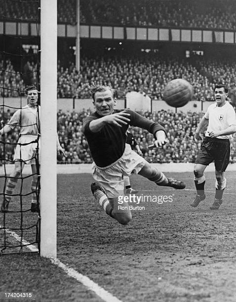 German goalkeeper Bert Trautmann , of Manchester City FC, makes a save during a First Division match against Tottenham Hotspur at White Hart Lane,...