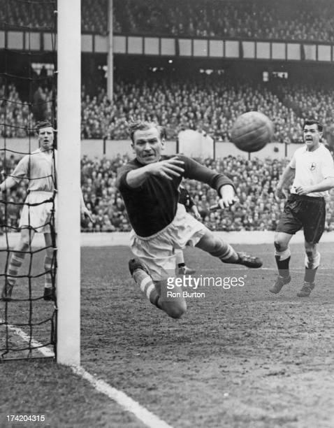 German goalkeeper Bert Trautmann of Manchester City FC makes a save during a First Division match against Tottenham Hotspur at White Hart Lane London...