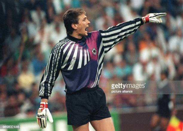 German goalkeeper Bodo Illgner shouts instructions at his teammates and emphasises these with wild gestures The German national soccer team wins...