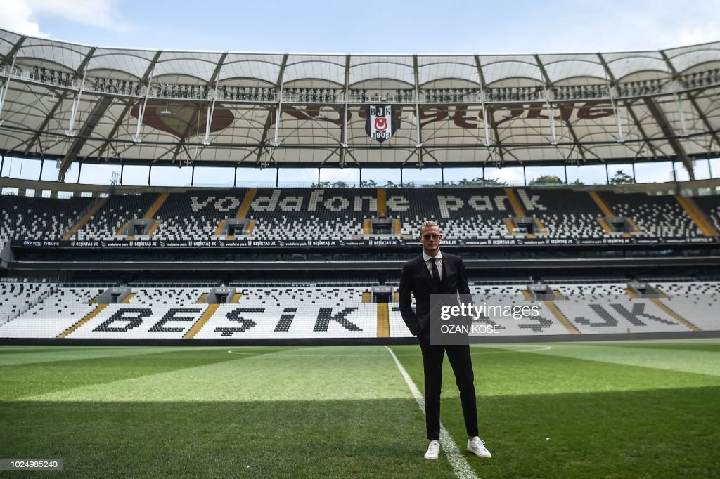 German goalkeeper Loris Karius poses on the football picth of the Vodafone Park Stadium, on August 29, 2018 after his presentation, in Istanbul. - Liverpool goalkeeper Loris Karius has joined Turkish football team Besiktas for a two-year loan deal.