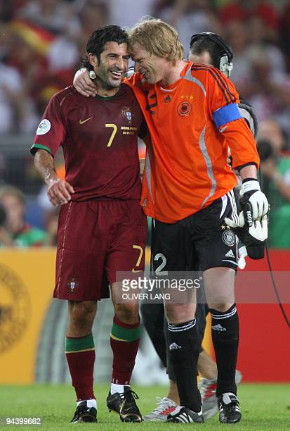 German goalkeeper Oliver Kahn and Portuguese forward Luis Figo share a moment at the end of the third-place playoff 2006 World Cup football match...