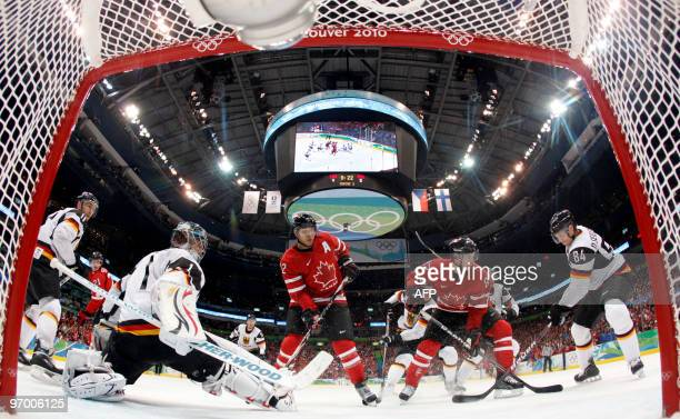 German goalkeeper Thomas Greiss eyes the puck during the Men's Ice Hockey playoff game between Canada and Germany at the Canada Hockey Place during...