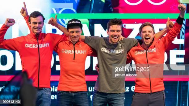 German gold medallists Vinzenz Geiger Eric Frenzel Johannes Rydzek and Fabian Rießle celebrate winning the men's team large hill/4 x 5 km Nordic...