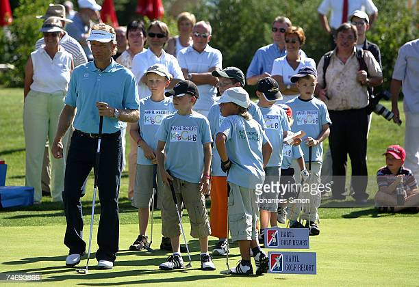 German golfer Bernhard Langer plays golf with with children during the opening of Hartl Golf resort on June 17 in Penning Germany