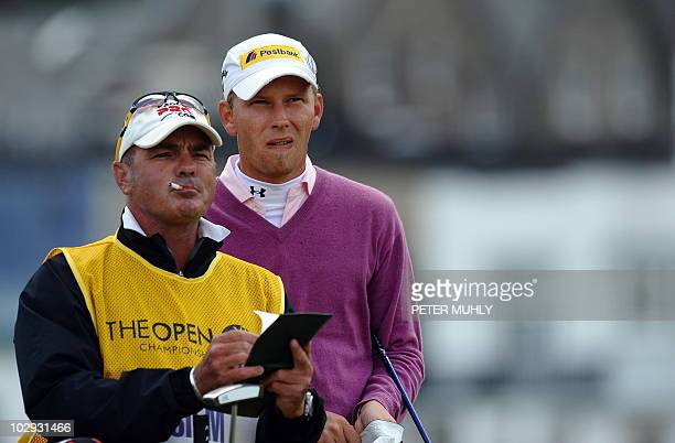 German golfer Marcel Siem and his caddie Kyle Roadley on the 2nd tee during his second round on day two of the British Open Golf Championship at St...