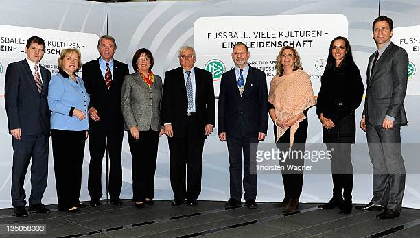 German govermants Integration coordinator Maria Boehmer president Theo Zwanziger and manager Oliver Bierhoff pose during the DFB and Mercedes Benz...