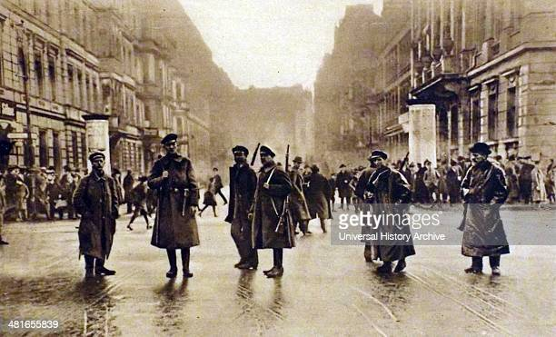German government forces stand in a Berlin street during the Spartacist rising of 1919 The Spartacist uprising was a general strike and the armed...