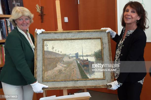 German Government's Commissioner for Culture and the Media Monika Gruetters hands over the painting Quai de Clichy by French NeoImpressionist Paul...