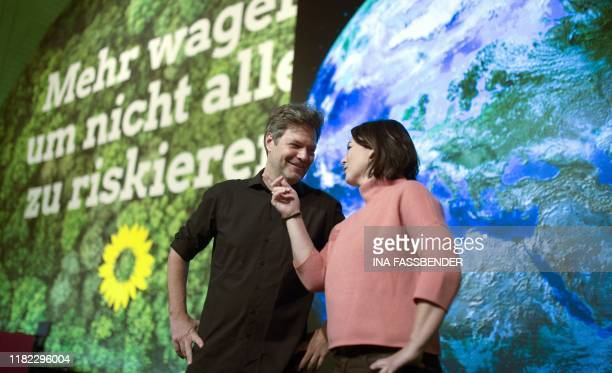 German Green party coleaders Annalena Baerbock and Robert Habeck pose for photographers as preperations continue for a twoday party congress in...