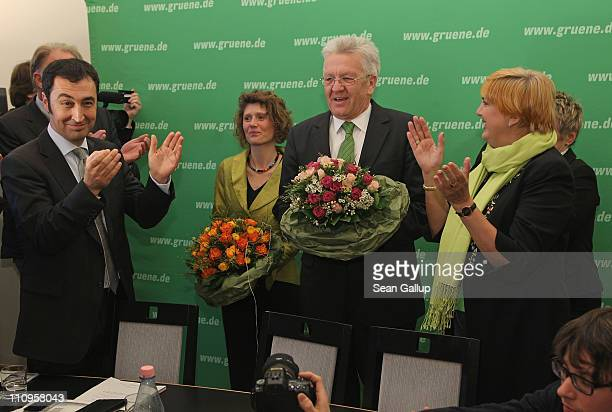 German Greens Party cochairman Cem Oezdemir and cochairwoman Claudia Roth welcome Greens Party candidate in the state of RhinelandPalatinate Eveline...
