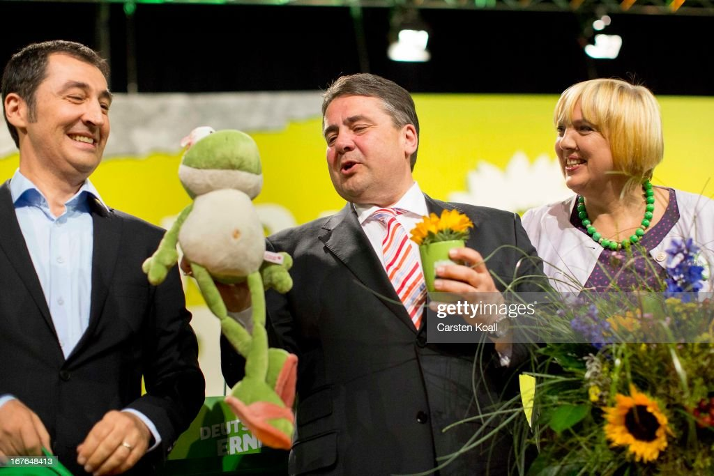 German Greens Party (Buendnis 90/Die Gruenen) co-chairman Cem Oezdemir, guest speaker SPD Chairman Sigmar Gabriel, who is holding a soft toy frog and a cup, a present by Cem Oezdemir, and co-chairwoman Claudia Roth, cheer after the speach at the second day on the three-day congress on April 27, 2013 in Berlin, Germany. Germany faces federal elections in September and the German Greens Party is hoping to win enough votes to govern in a coalition with the German Social Democrats (SPD).