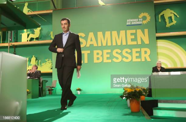 German Greens Party cochairman Cem Oezdemir walks to the podium to speak to delegates at the Greens Party federal convention on November 16 2012 in...