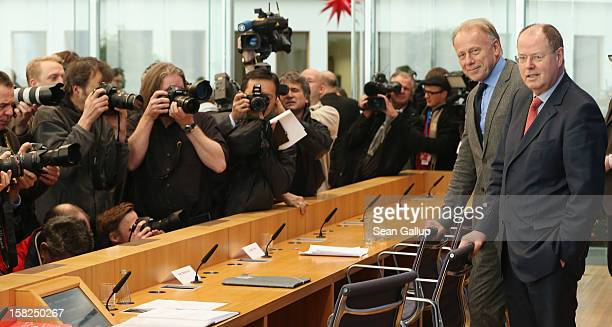 German Greens Party cochancellor candidate Juergen Trittin and German Social Democrats chancellor candidate Peer Steinbrueck arrive to present a...