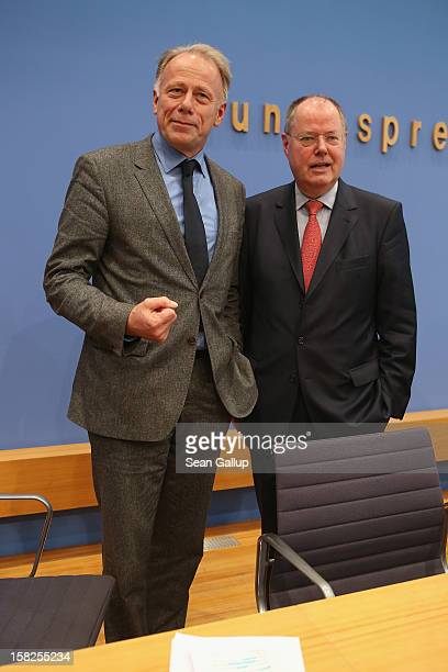 German Greens Party cochancellor candidate Juergen Trittin and German Social Democrats chancellor candidate Peer Steinbrueck depart after presenting...