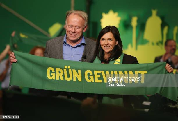 German Greens Party cochancellor candidates Katrin GoeringEckardt and Juergen Trittin hold up a banner that reads Green Wins after both spoke at the...
