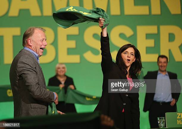 German Greens Party cochancellor candidates Katrin GoeringEckardt and Juergen Trittin celebrate after both spoke at the Greens party federal...