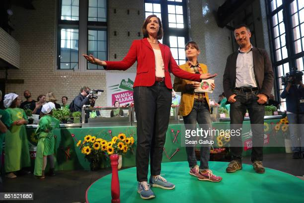 German Greens Party colead candidates Cem Oezdemir and Katrin GoeringEckardt speak to supporters at a 'spaghetti party' election rally on September...
